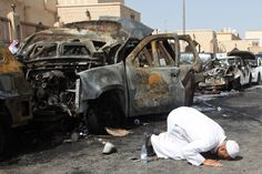 Week of May 29, 2015 The cousin of a victim prays at the site of a suicide bombing that targeted a Shiite mosque in the Saudi coastal city of Dammam on Friday. Islamic State said it was responsible for the attack, which left several people dead. AGENCE FRANCE-PRESSE/GETTY IMAGES