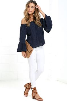 When the Looking Forward Navy Blue Off-the-Shoulder Embroidered Top is coming your way, the future will seem oh-so-bright! Gauzy woven fabric is embroidered across an elastic, off-the-shoulder neckline. Wide-cut bodice lays between long bell sleeves.