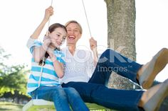 Happy blonde swing with her daughter royalty-free stock photo