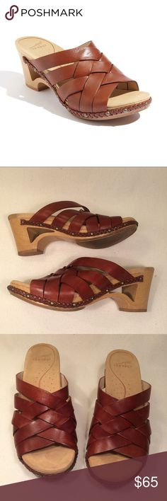 """Dansko Tory Wooden Brown Studd Clogs 〰Excellent pre-owned condition!                                                      〰Let me know if you have any questions 〰Accepting all reasonable offers made through the offer feature 〰Add any item/s to a bundle using the """"add to bundle feature"""" to get an additional private discount!🌵✨ Dansko Shoes Mules & Clogs"""