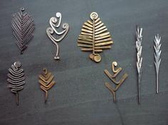 Alexander Calder.   Clockwise from top left;   Brooch, c. 1940, Leaf brooch, c…