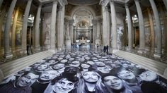 """The Panthéon in #Paris, a secular temple dedicated to the """"great men of the republic"""", is playing host to the faces of thousands of unknown men, women and children."""