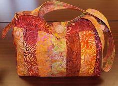 Nancy S's Ashley Tote in pinky peachy batiks. Just like Sarah's! Fabrics chosen by Talei Robinson.
