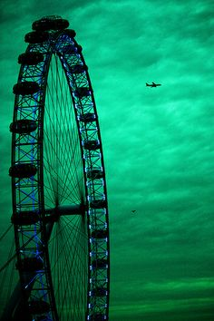 look at the amazing colour of the sky, like jade and aqua tones to me, but i'm placing it on my blue/green board because of the blue light around the ferries wheel. Carrousel, Carnival Rides, Green Sky, Emerald City, Emerald Green, Emerald Colour, World Of Color, Roller Coaster, Shades Of Green