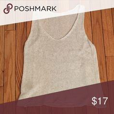 Brandy Melville sweater tank Tan Brandy Melville sweater tank. Great condition but tore off tag because it was itchy. No trades sorry! Brandy Melville Tops Tank Tops