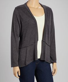 A lovely layer on any ensemble, this open cardigan features a fluid, draped design. Its effortless elegance will prove a staple in any closet collection.
