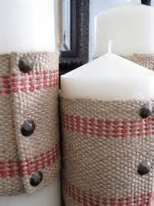 wrap candles in burlap and tack them in