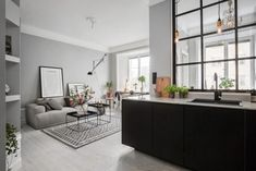 Grey walls and a steel-framed indoor window Living Pequeños, Scandi Living, Home And Living, Kitchen Living, Living Room, Kitchen Grey, Room Kitchen, Living Area, Small Space Living