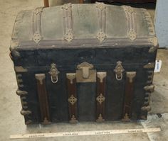 VINTAGE DOME TOP HUMPBACK STEAMER TRUNK WITH LEATHER HANDLES. IT HAS METAL HARDWARE AND IS LINED INSIDE. MEASURES 27 INCHES TALL, 30 INCHES WIDE AND 18 INCHES DEEP