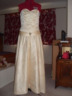 redesigned wedding dress. has lace skirt panel at front and long train at the back.