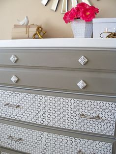 Paint and decorative aluminum sheeting gives new twist to old dresser.