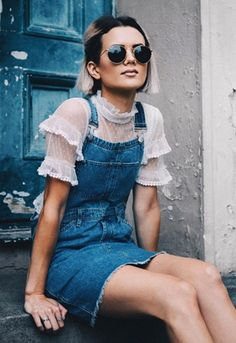 Blogger wearing short frilled-sleeve top under a denim pinafore dress on ASOS…