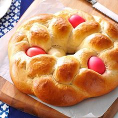 Easter Egg Bread Recipe -I've made this Easterd treat for 20 years! Colored hard-cooked eggs baked in the dough give this sweet bread such a festive look. Leave them out and it can be enjoyed anytime of year. My husband especially enjoys this bread with baked ham. -Heather Durante, Wellsburg, West Virginia