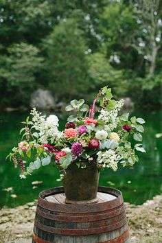 oversized floral arrangement, photo by Brooke Courtney Photography http://ruffledblog.com/shenandoah-valley-wedding #weddingflowers #flowers