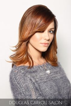 Subtle cinnamon and toffee highlights add depth to layered strands for a wind-swept style that speaks to the senses.