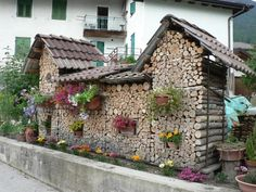 Collection of artisitc wood piles - some look like houses