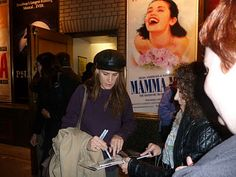 Rachel Griffiths (Brooke Wyeth in her Broadway debut in Jon Robin Baitz's family drama Other Desert Cities)  signs autographs outside the stage door at the Booth Theatre.