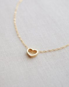 Heart Outline Necklace by Olive Yew. Cute and simple open heart necklace is available in gold or silver and is perfect to add a sweet touch to any outfit.