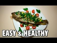 Easy & Healthy Fish Recipe. Simple fish recipe. Quick and easy! Carp fish baked in the oven. Food: carp fish, onion, bay leaves, pepper, lemon, cherry tomatoes, greens, vegetable oil, salt. Bake in the oven 60 min./392°F (200°C). Cooking the fish in the oven is quick, simple, delicious and healthy! (+ how to peel fish trick)