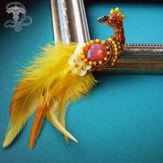 """Брошь """"Жар птица"""" с пушистым хвостиком и солнечной раскраской. . Брошка очень легкая и миниатюрная, аккуратное исполнение в технике вышивки бисером. Изнанка закрыта нежной кожей в тон, брошь держится на удобной булавке с предохранителеем. Материалы: Хрусталь, японский бисер, пайетки, натуральная кожа, латунная фурнитура, чешские бусины, канитель, перо натуральное. Размер: 7*3 см. с хвостом 15 см. Мой личный профиль @liliya_berezina @lilytiger_jewellery"""