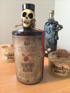 Fun, creepy bottles for Halloween! Reused old jars and bottles aged with acrylic paint. Used Fimo clay to make the decor.