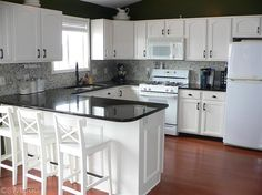 Kitchen with granite counter top and glass tile backsplash