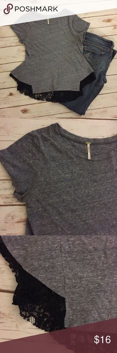 Free People Gray Jersey Lace Top L Condition: No rips, stains or tearsColor: black/gray   Fabric: cotton blend   Pulls on  Machine wash  Measurements:  17 inches across bust  23 inches length Free People Tops