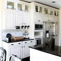 Space saver/great look: add a row of glass front cabinets over your existing cabinets.