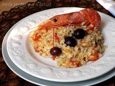 Risotto+al+pesto+con+gamberoni+e+olive+nere