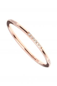 this rose gold diamond ring adds a delicate sparkle to any
