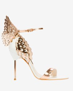 Sophia Webster Evangeline Angel Wing Sandals: A scalloped edge 3D cut out angel wing detailing extends from the backstay on these patent and metallic leather sandals. 3 super skinny metallic heel. Single band at open toe. Adjustable ankle strap. In Rose gold wings and white leather. Made in ...