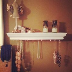 how to organize jewelry............storing jewelry on a shelf you already have in your room. Drill some holes in the bottom and add little hooks to hang your jewelry from.   Read more: http://www.gurl.com/2014/03/13/easy-tips-on-how-to-organize-your-jewelry/#ixzz35MpD3kvX