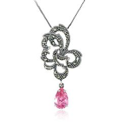 "Sterling Silver Marcasite and Pink Simulated Diamond Pendant Necklace , 18"" Amazon Curated Collection. $30.00. Marcasite can appear iridescent in the light.. Made in Thailand. The natural properties and composition of mined gemstones define the unique beauty of each piece. The image may show slight differences to the actual stone in color and texture.. Save 64% Off!"