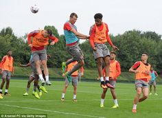 Granit Xhaka, Bielik and Akpom go up for a header during training at London Colney