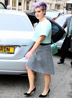 Lilac lady: Kelly made a colourful impression as she left Claridges hotel in a mint green ...