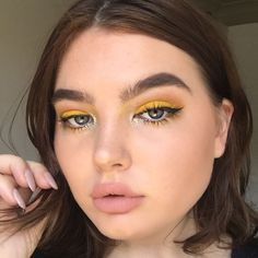 Image result for bright yellow eye makeup
