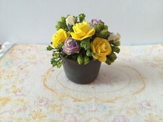 A personal favorite from my Etsy shop https://www.etsy.com/listing/293916875/dollhouse-flowers-miniature-flowers