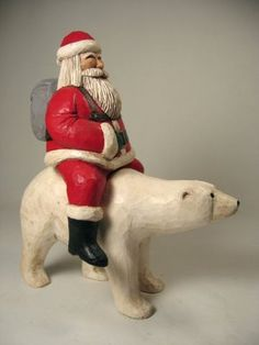 Hand carved Santa and Polar