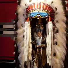"""This Victory Headdress is of a plains-style construction. Measuring in at over 36"""" long, this piece is impressive in both size and craftsmanship. Each feather is carefully painted, and each bead is pa"""