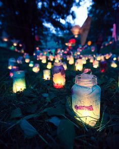 Idea for lining the paths from wedding reception to bathrooms...Put tissue paper in a mason jar, then a flameless candle (battery operated) and put lid on.