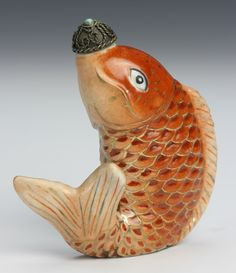 China, 19th C., Famille Rose snuff bottle in the form of a brightly colored fish, with stopper. Height 2 3/4 in.