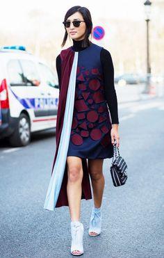 Nicole Warne of Gary Pepper wearing a geometrical print dress with peep-toe boots