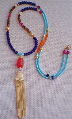 MALA TASSEL NECKLACE by Gwen's Creations for PinkCalyx.com, Jewels for a Cause A beautiful array of exotic colors, this eastern inspired necklace is composed of genuine turquoise, carnelian, blue jade, peridot and hessonite. A shimmer tassel creates a perfect meditation necklace. A portion of Gwen's profits benefits Off the Mat World.