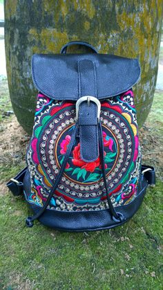 A personal favorite from my Etsy shop https://www.etsy.com/sg-en/listing/254389877/black-hmong-boho-leather-embroidery-bag