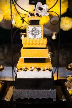Black and yellow modern Spanish-inspired wedding cake