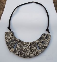 Bib-style sutton-slice necklace by Lily Fimo featuring stamps Roundabout, Fandango & Congaline.