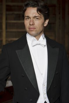 Handsome Charles Blake is introduced to the Crawley's by Evelyn Napier, who works in the same Government department. They are undertaking a study to examine estates like Downton and others in North Yorkshire that may be facing difficulties in a changing society. Played by Julian Ovenden.