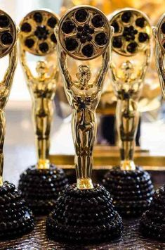 Bedazzle #Oscar statues for each place setting at your party to watch the #Academy Awards with your friends!