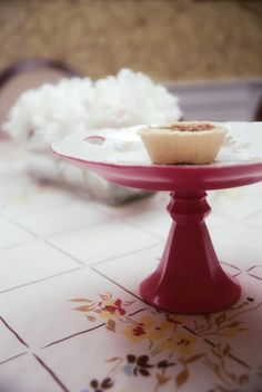 Cakestand made using a plate and candlestick holder from the thrift shop.