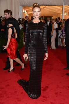 Pin for Later: 73 Times Rosie Huntington-Whiteley's Sexy Looks Scorched the Red Carpet  Rosie kept her look sleek and simple while attending the 2012 Met Gala in a draped Burberry dress.